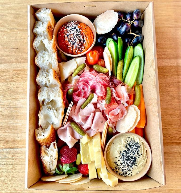 A mix of delicious condiments, dips, meats and cheeses from the Deli